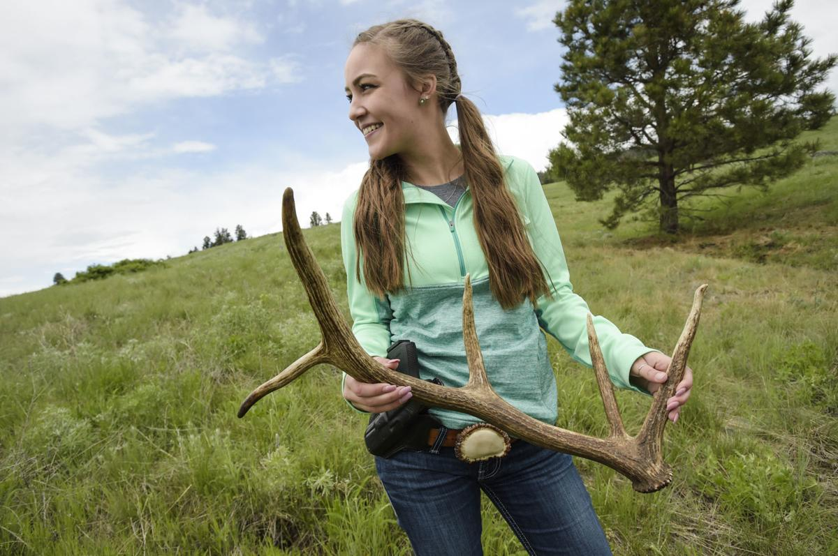 With a grin, Libby Diller holds her first elk shed
