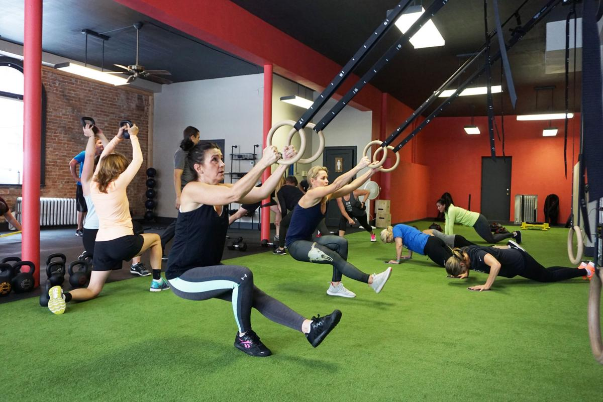 Fitness in motion: Former Tech football players open gym with modern
