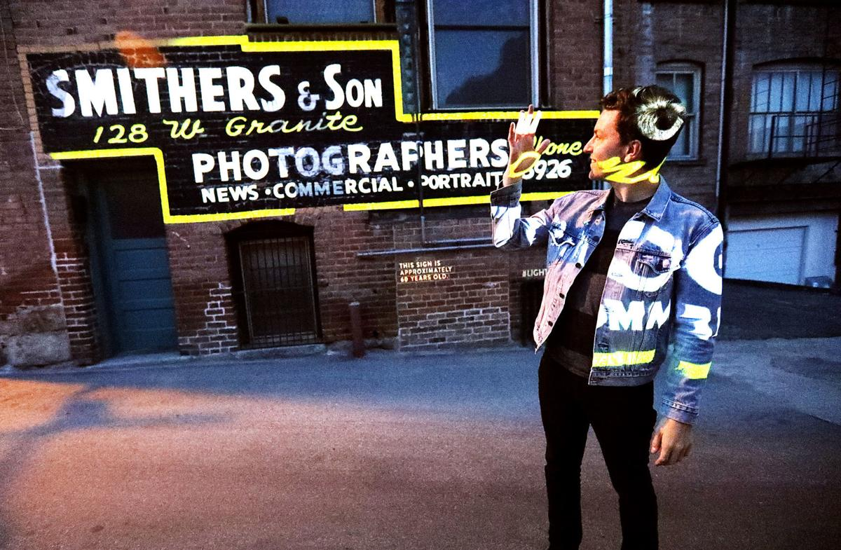 Projection artist brings ghost signs to life in Uptown Butte