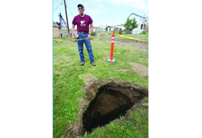 Look Out Down Below: Four Foot Sinkhole Opens In Butte Back Yard