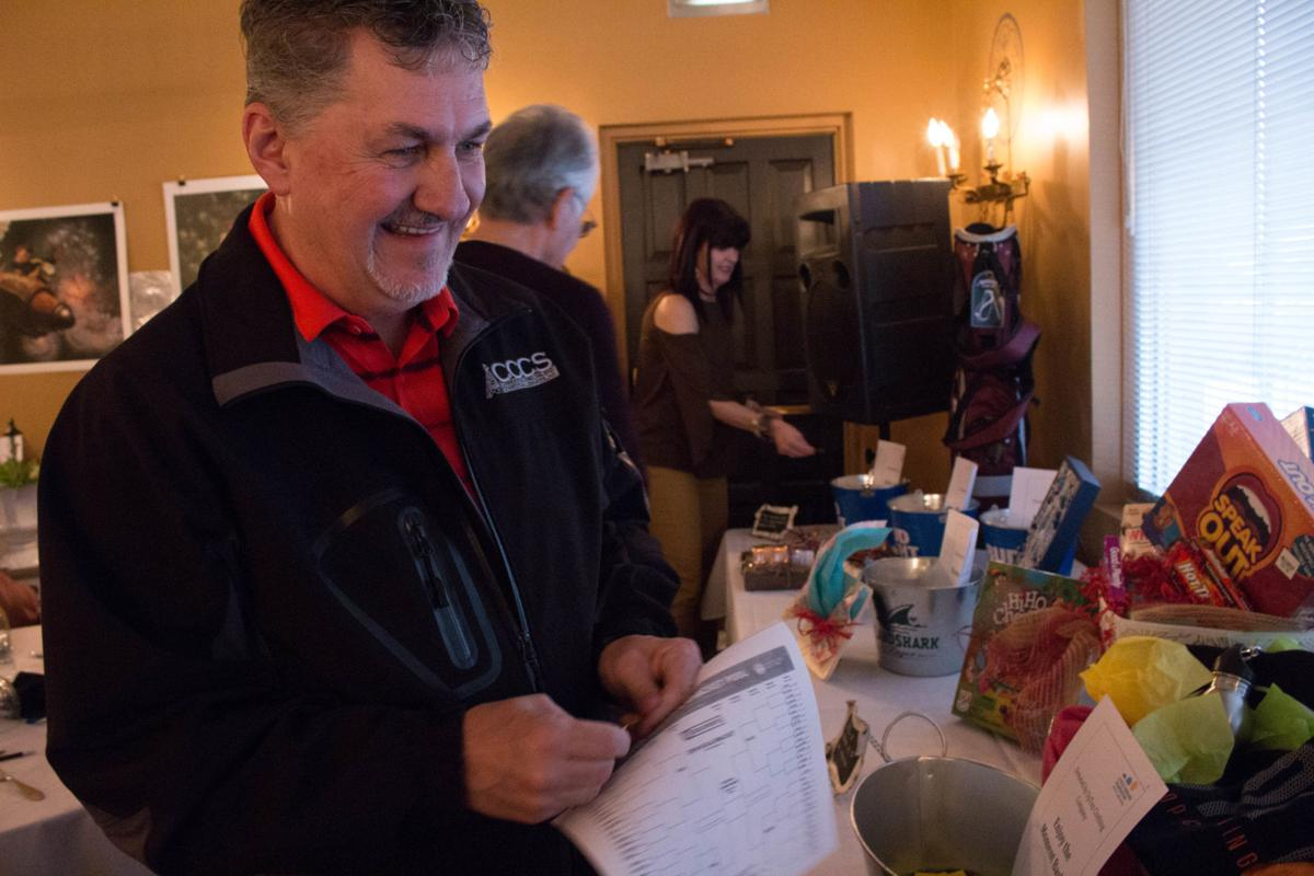 Hundreds attend annual Calcutta auction at the Butte Country Club