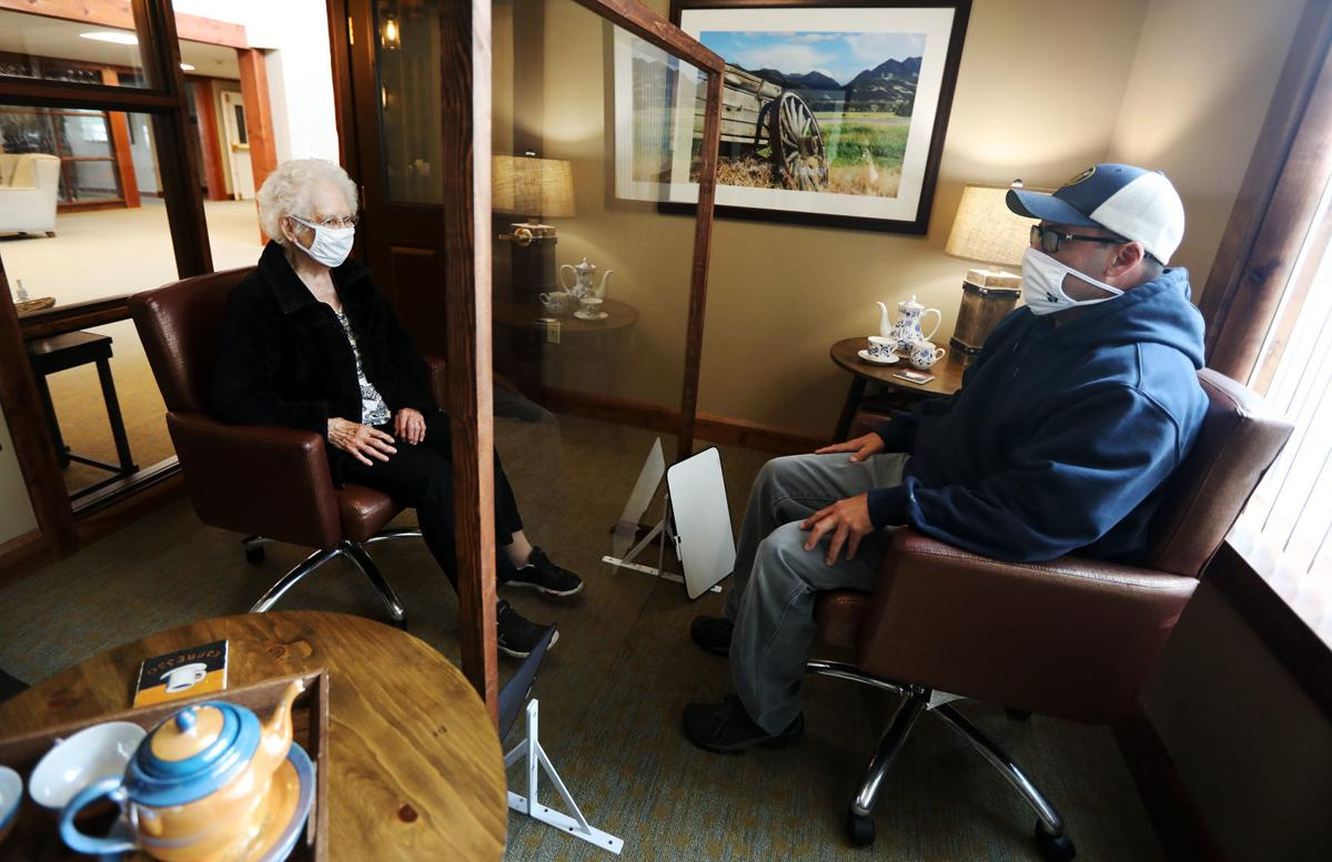 Butte nursing home uses glass partition to help residents connect with family