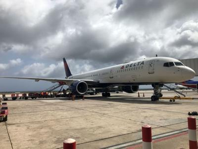 A Delta Airlines Airbus 321 jet at Aruba Reina Beatrix International Airport sit at gate on June 25, 2018