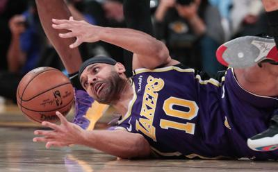 The Los Angeles Lakers' Jared Dudley scrambles after a loose ball against the Orlando Magic at Staples Center in Los Angeles on January 15, 2020.