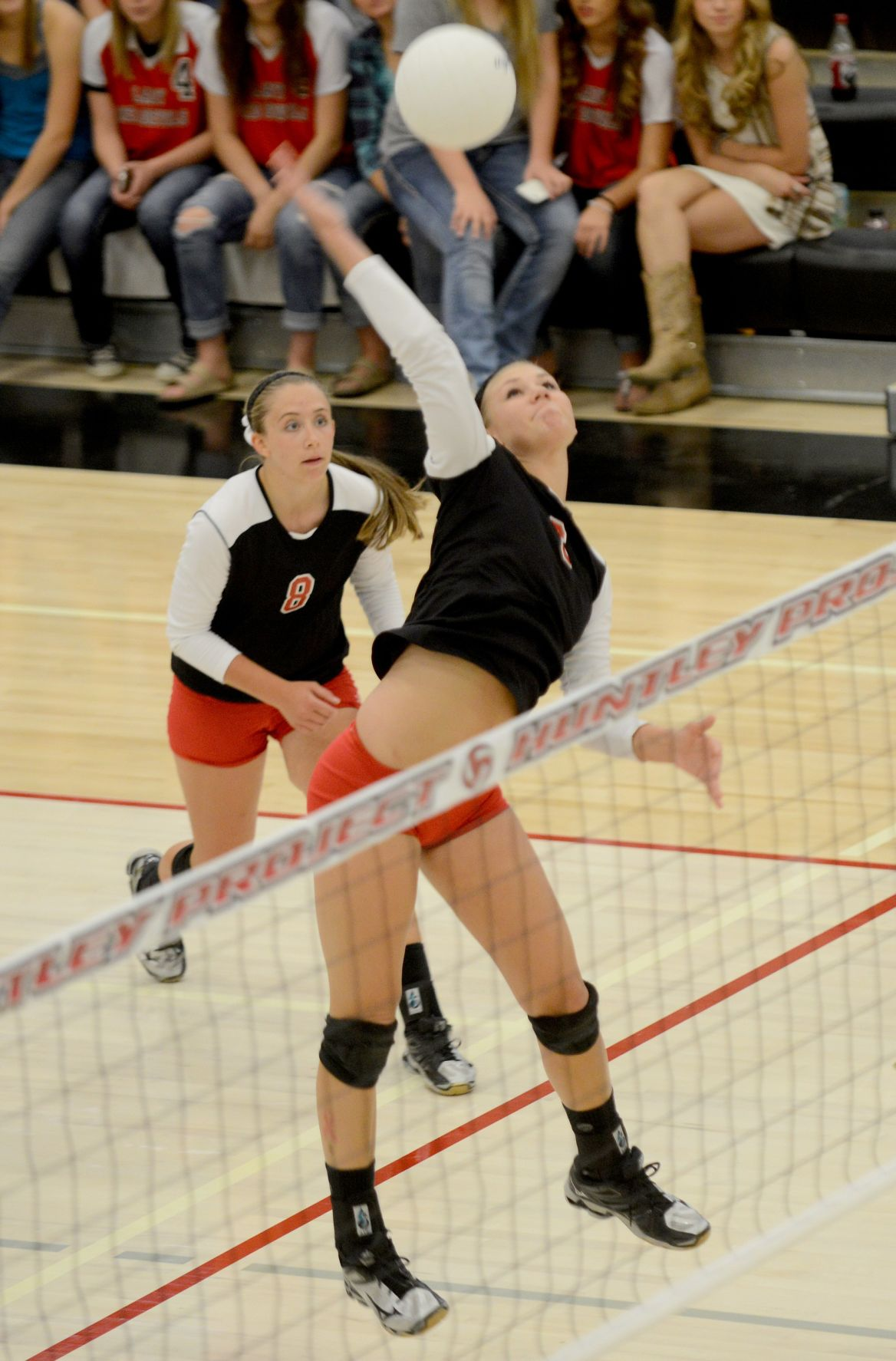 Huntley's Cady Siemion spikes the ball