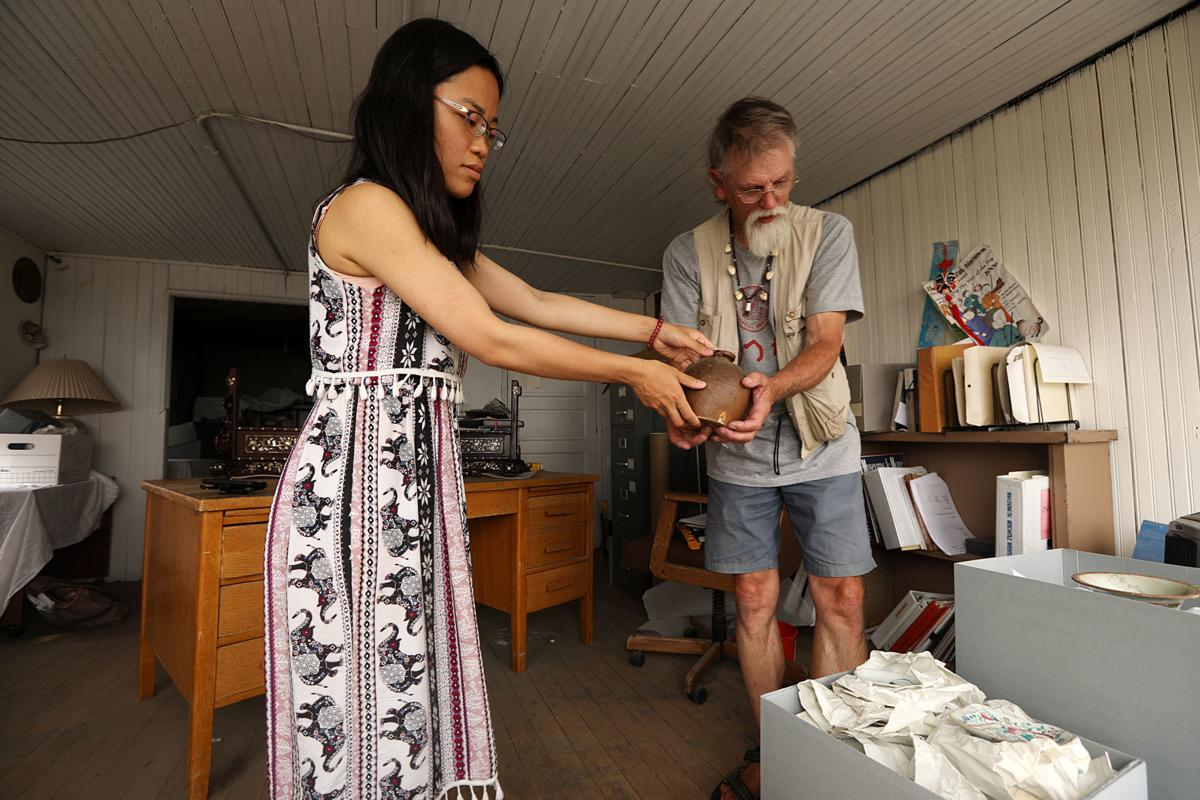 Mai Wah receives artifacts from Chinn family