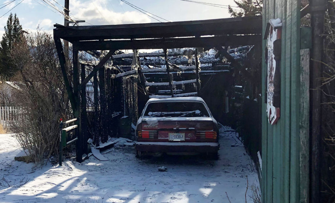Fire destroys car, carport