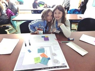 Girls engaging in after-school STEM projects