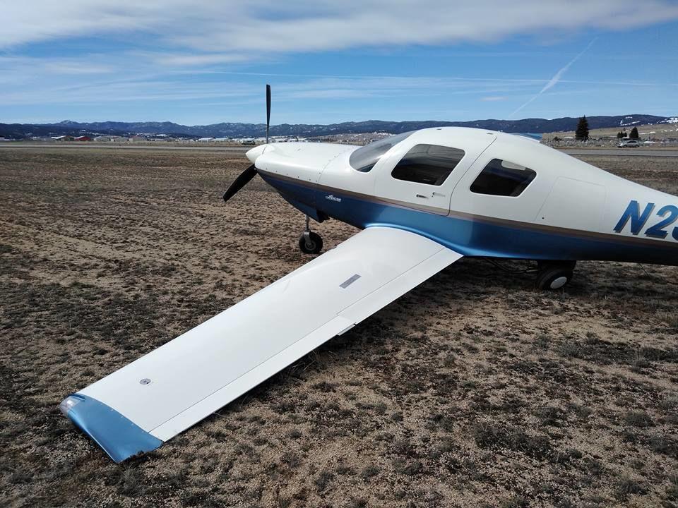 Aircraft lands in grass
