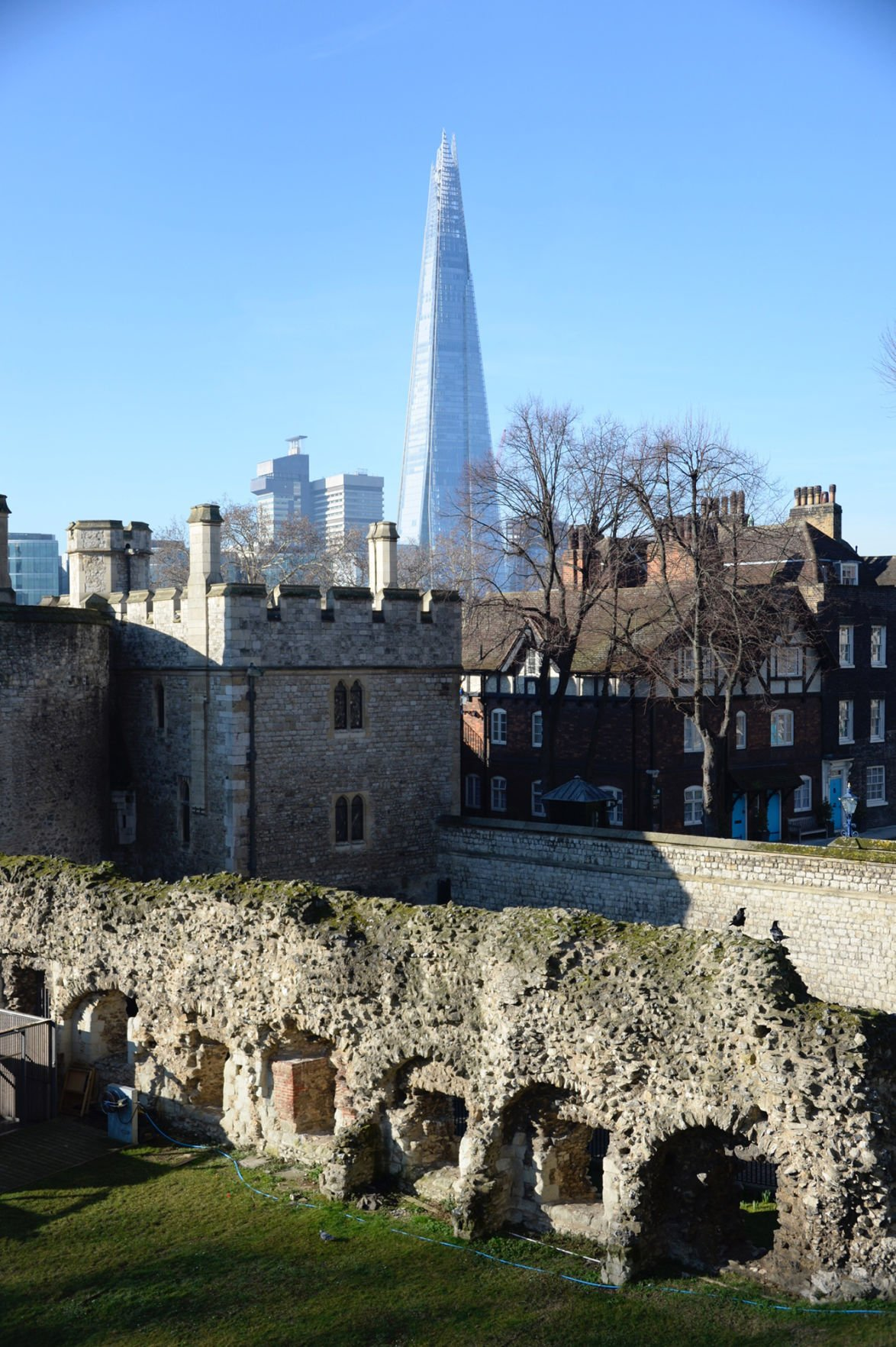 London old and new: The Shard tower rises above remnants of the Roman wall dating from 200 A.D. near the Tower of London.