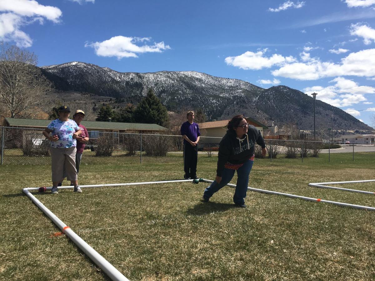 Kourtney Hunking throws a bocce ball