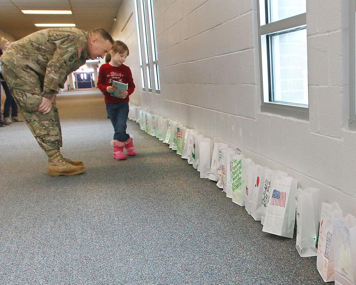 Linking to the real world: Veterans visit elementary kids