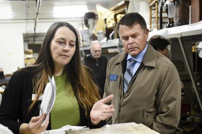 Montana Historical Society curator Jennifer Bottomly-O'Looney, left, and Sen. Terry Gauthier, R-Helena,