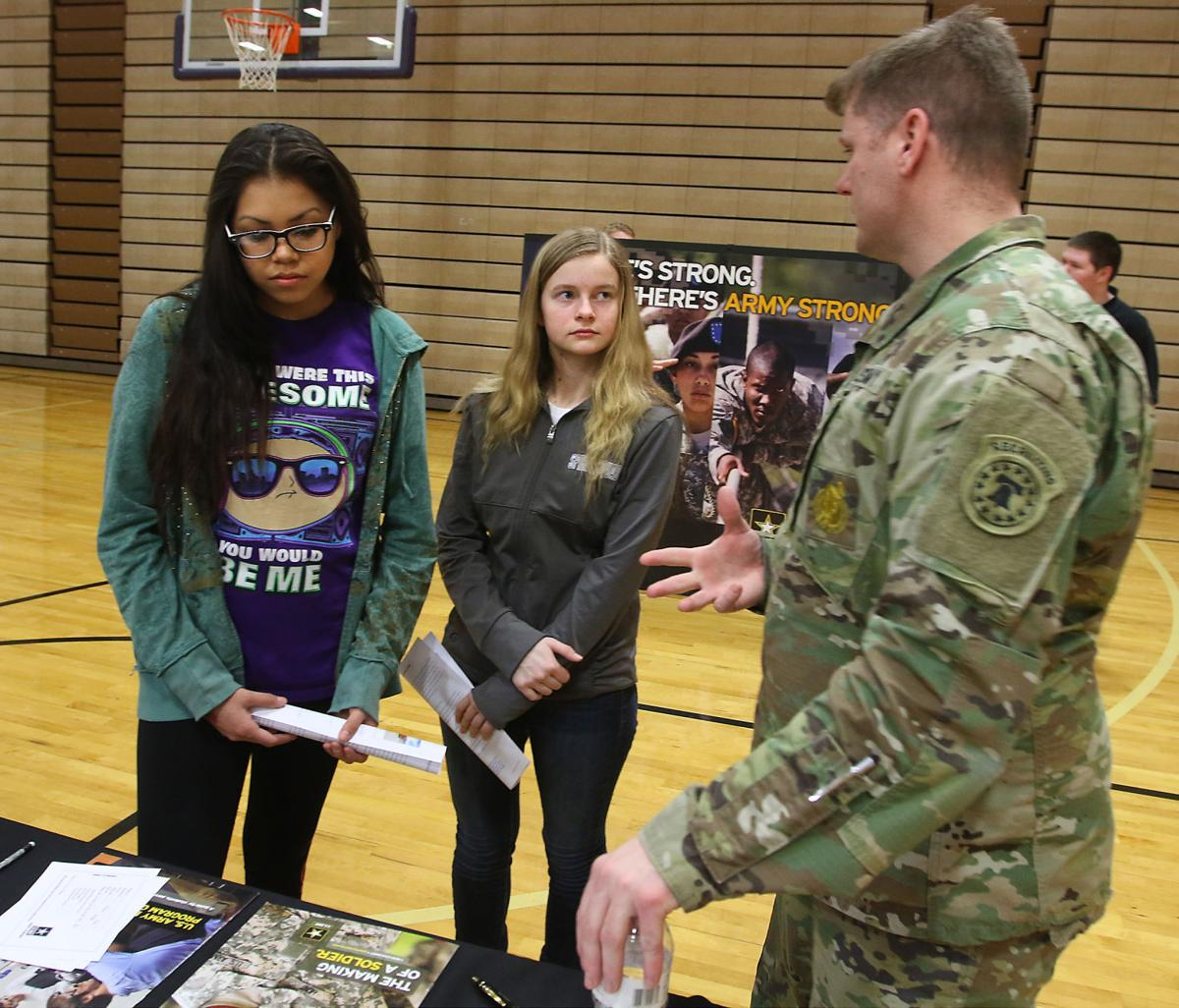 Army recruiter talks with students