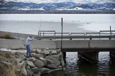An angler on the open water around the causeway between Hauser Reservoir and Lake Helena