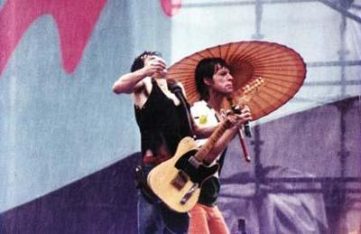 Its Only Rock N Roll But Butte Fans Like It This Photo Of Mick Jagger With A Parasol Was Taken During Rainy Rolling Stones Concert In Dallas 1981