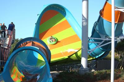 Aquatica Orlando's newest water slide, KareKare Curl, opened in April 2019. Two riders, who face each other on the raft, experience a 35-foot drop in the enclosed tube and then rush up a vertical wave wall. The ride takes about 15 to 20 seconds to complete.