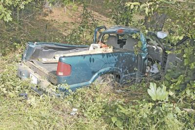 Truck lands in ravine