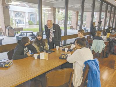 Robertson visits students
