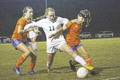 Lady Marshals climb all over Lady Tigers, win district title