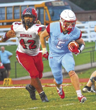 Jacob Watters runs by a defender