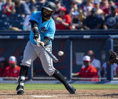 Miami Marlins center fielder Jonathan Villar (2) swings at a pitch during the fourth inning of a Spring Training game against the Washington Nationals at FITTEAM Ballpark of the Palm Beaches Monday, March 2, 2020 in West Palm Beach, Fla.