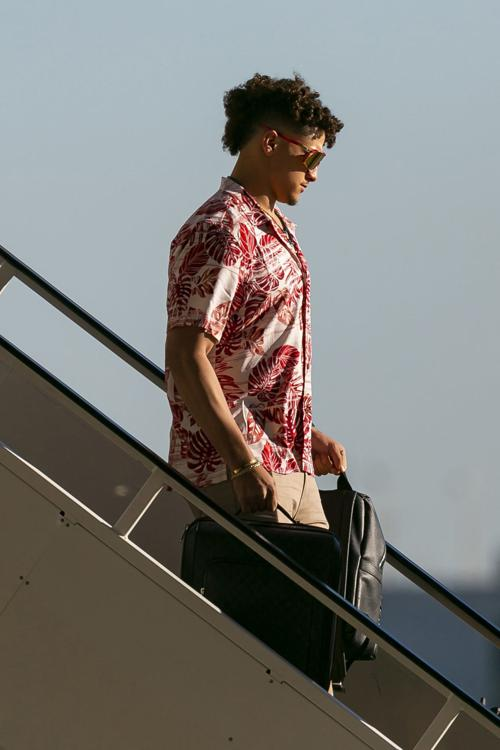 Kansas City Chiefs quarterback Patrick Mahomes (15) arrives alongside teammates and coaches at Miami International Airport in Miami, Fla. on Sunday, Jan. 26, 2020. The Kansas City Chiefs will face off against the San Francisco 49ers at Super Bowl LIV in Hard Rock Stadium next Sunday, Feb. 2, 2020.
