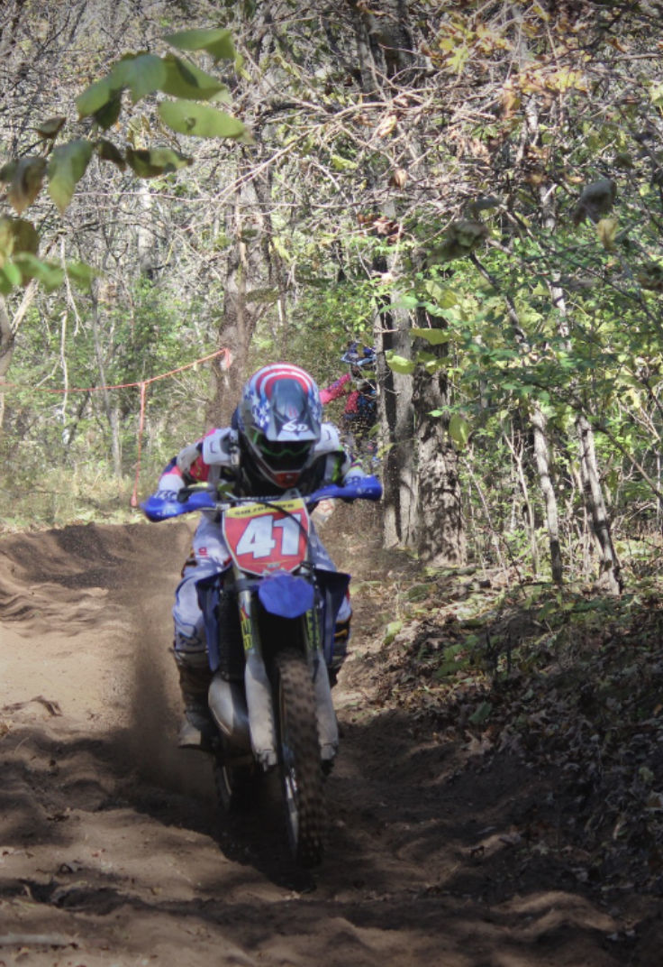 f3f7ca82 Muscatine's Zack Sulzberger rides his dirt bike during one of the races he  competed in. He and his father, Barry, took first and second in the Iowa  Enduro ...
