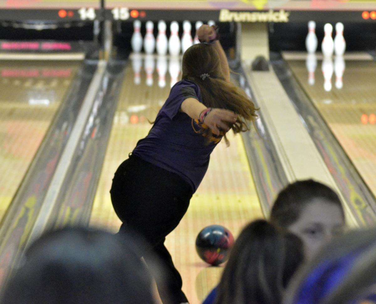 286e4b101e0 Muscatine's Gabi Evans watches her ball roll down the lane during the  Muskie Invitational at the Rose Bowl this past season.