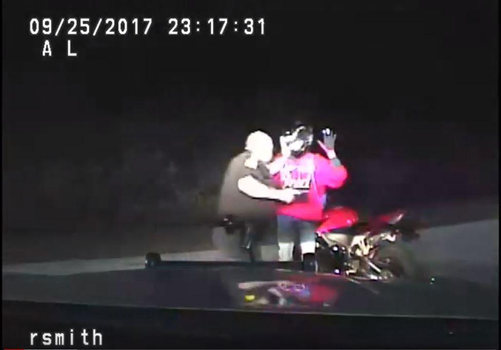 Dashboard camera video of Iowa trooper striking motorcyclist during stop
