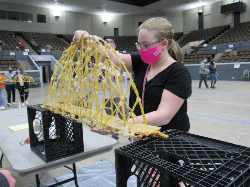 Competition features spaghetti bridges, paper airplanes