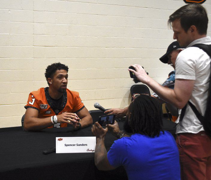 Gundy dives into QB questions as Brown, Sanders meet the media