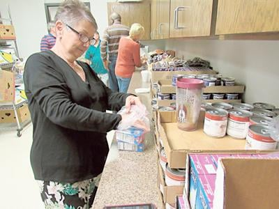 Church volunteers provide weekend nutrition for students