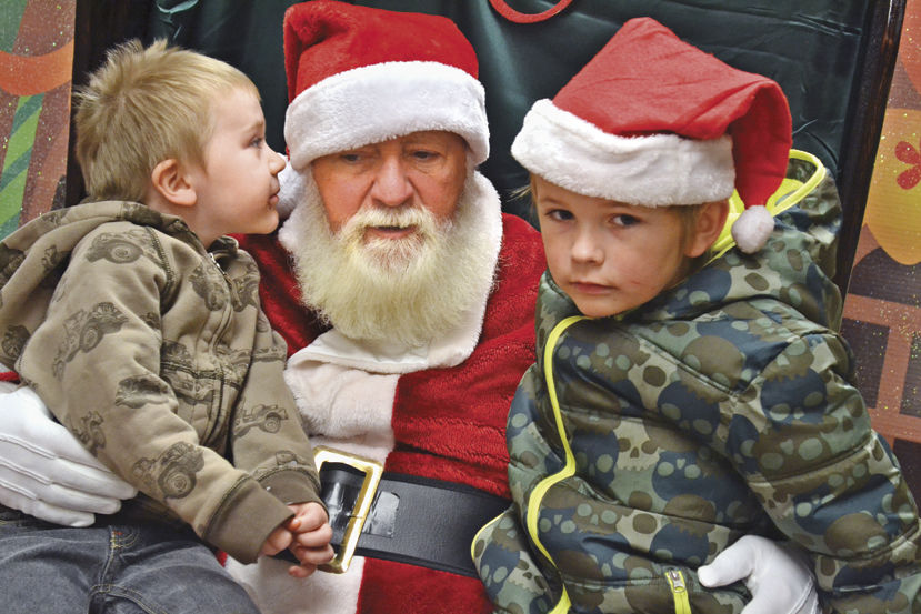 Jacob Walker and Braden Lord with Santa