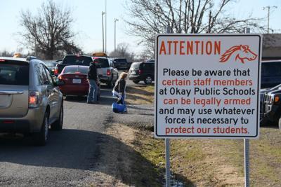 Warning sign at Okay