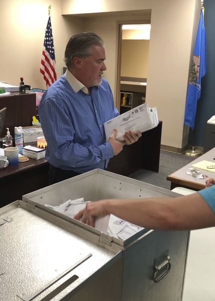 Local election officials verify historic number of absentee ballots