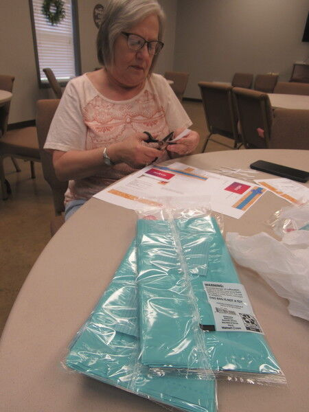 Churches fill bags to honor Muskogee's teachers