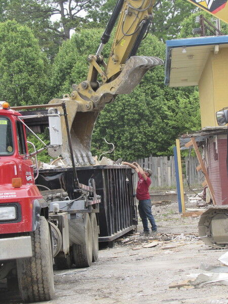 Former motel meets its demise