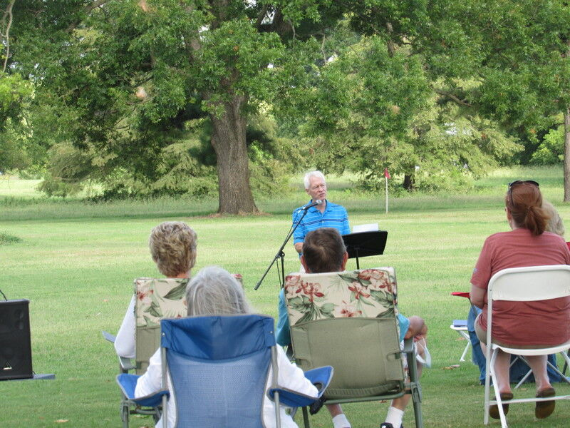 Church members worship service held at soccer complex