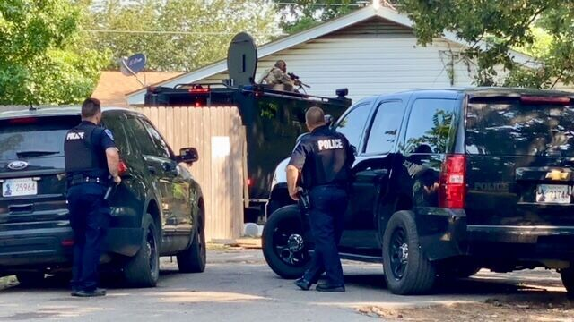 Cherokee Nation Special Operations Team surrounding the residence