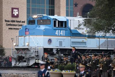 Crowds Turn Out In College Station For Bush Casket S Arrival By