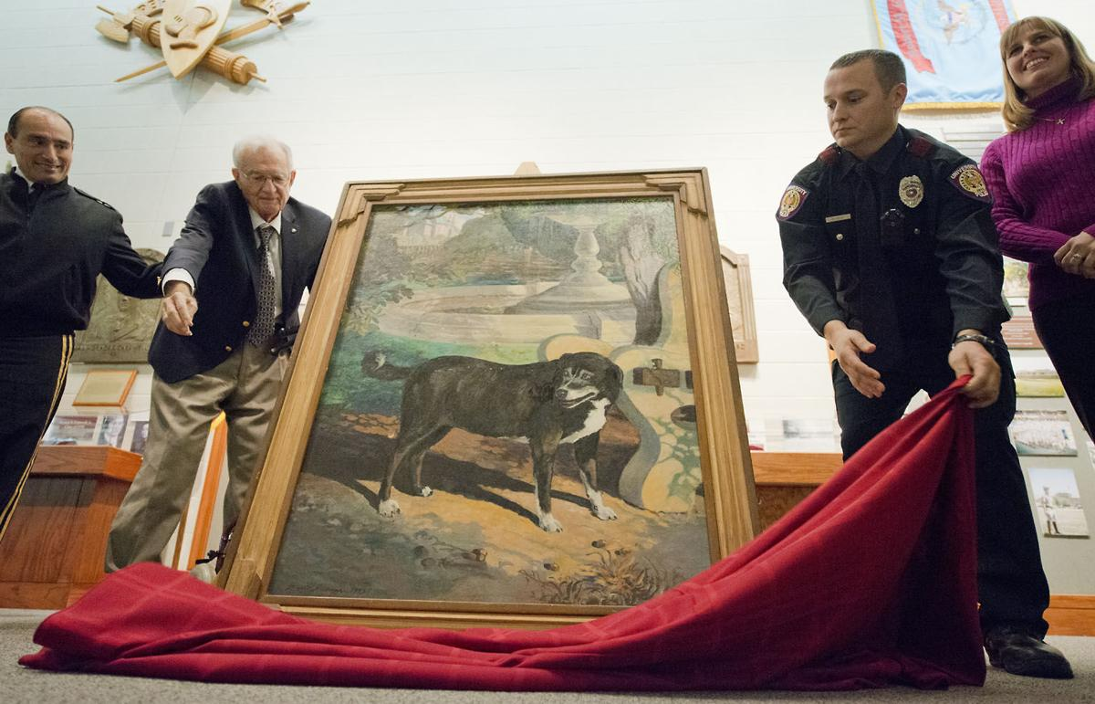 Texas A&M welcomes back Reveille I painting with re-unveiling ceremony