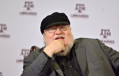'Game of Thrones' creator George R.R. Martin presents first edition 'Hobbit' to Cushing Memorial Library as 5 millionth volume