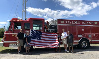 Andy Harris gives flag to Taylors Island Volunteer Fire Company
