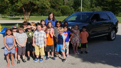 Moore gets car as Teacher of the Year