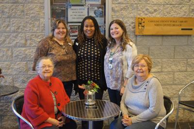Town and Country Club donates furniture to Greensboro Library