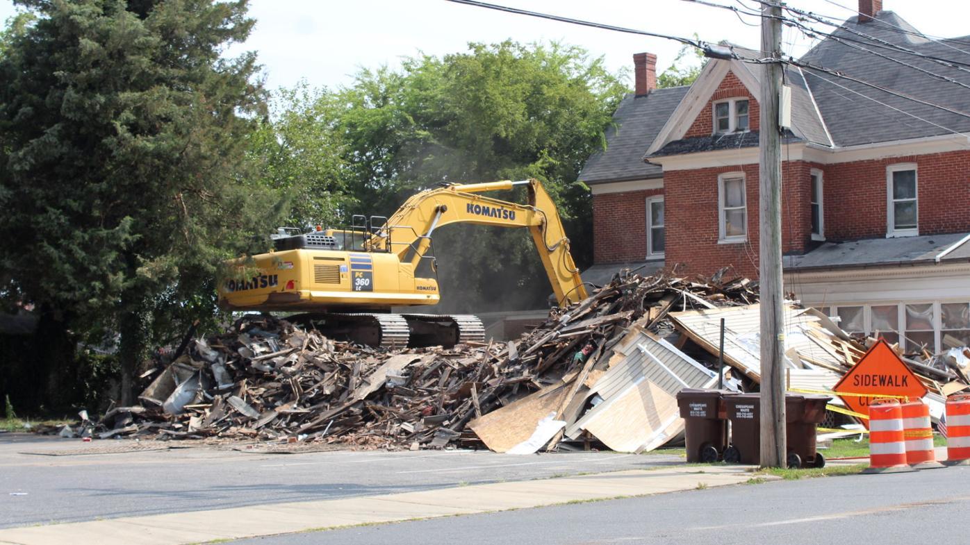 Excavator demolishes High Street house