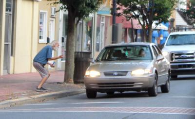 Man approaches car on Race Street