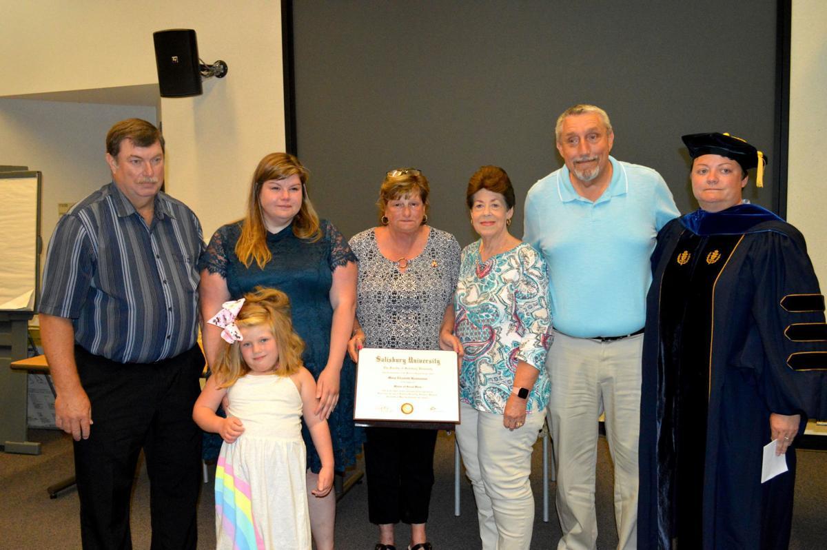 Salisbury University presents a master's degree to the family of Mary Elizabeth Bremmaman