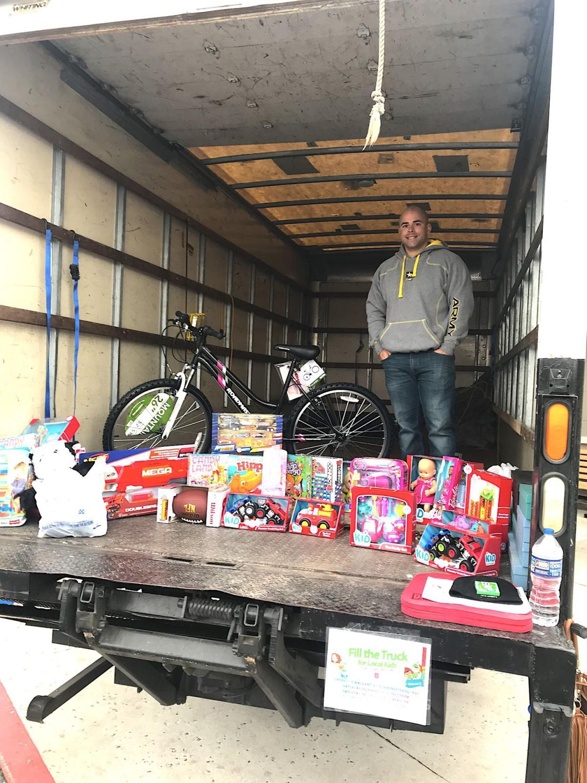 Filling the truck to fulfill Christmas wishes